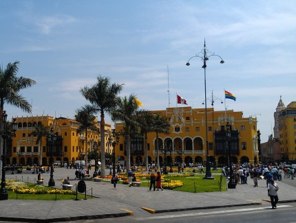 A beautiful historic district. This view shows the city hall of Lima. Notice the flag at the right representing the indigenous nations.