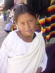 A lovely girl helps her mother to sell merchandise in Ecuador. She actually sold me a pair of alpaca gloves.