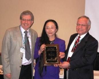 Wei Li receives the scholar award from Stavros Constantinou.
